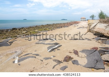 Road debris and buildings collapsed in the sand beach. - stock photo