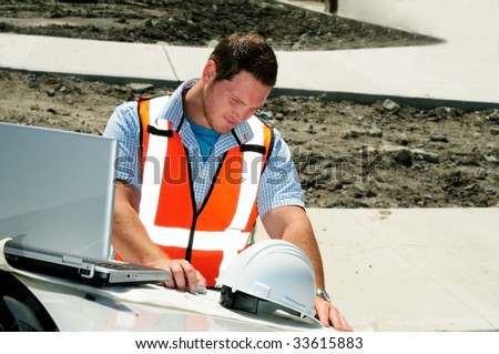 Road Engineer Checking Plans To A New Highway - stock photo