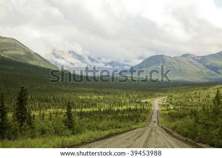 Road entering into Denali Highway in Alaska - stock photo