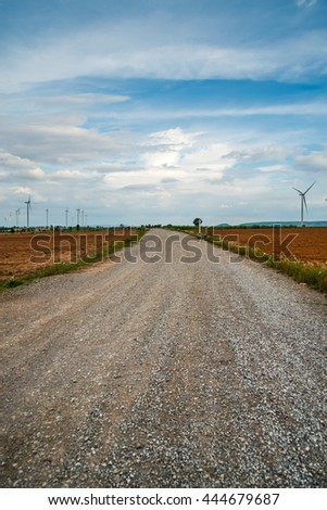 Road for Wind turbines generate electricity at field all agriculture plantation in thailand - stock photo