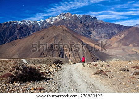 Road from Muktinath to Jomsom, a part of Annapurna Circuit trek in Annapurna conservation area, Nepal. Annapurna circuit the popular trekking trail. - stock photo