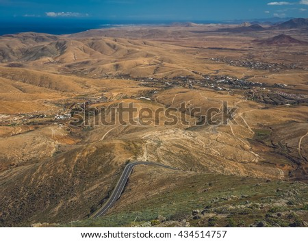 Road going through the landscape of Fuerteventura as seen from the Morro Velosa viewpoint, Canary Islands, Spain - stock photo