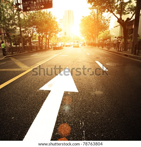 road in city with sunset - stock photo