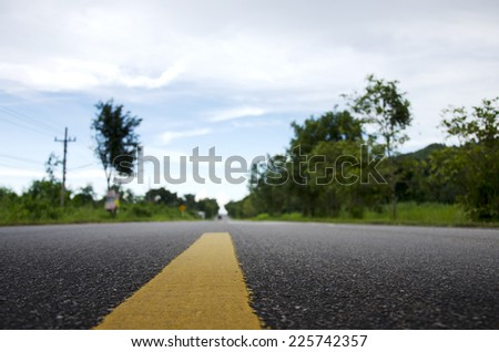 Road in countryside low angle with blurred background - stock photo