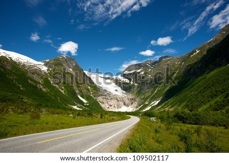 Road in norwegian mountains - stock photo