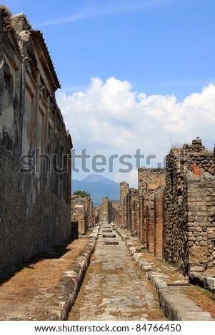 Road in Pompeii, buried Roman city near Naples, Italy - stock photo