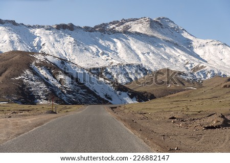 Road in the Atlas mountains in Morocco - stock photo