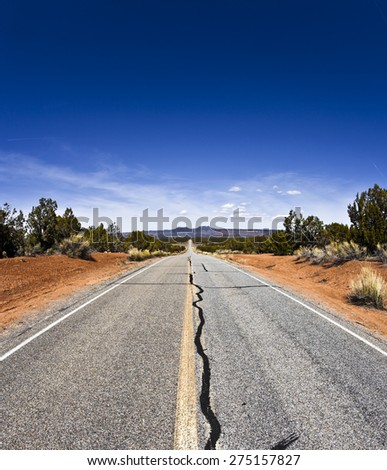 Road in the Desert of Arizona near the Grand Canyon National Park during a sunny summer day - stock photo