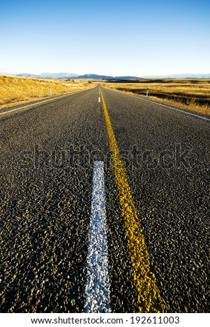 Road in the middle of a remote place. - stock photo