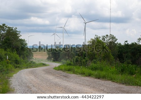 road in wind generator farm. thailand - stock photo