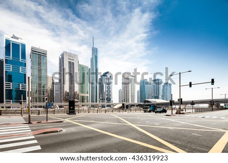 Road intersection in modern city - stock photo