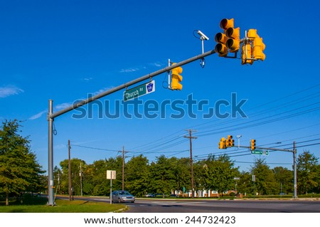 Road intersection in small town - stock photo