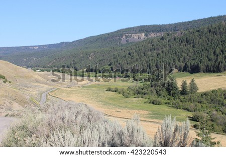 Road into the ranch lands - stock photo