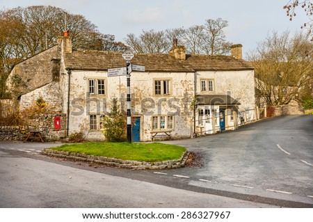 Road junction in the village of Malham, Yorkshire, England. - stock photo