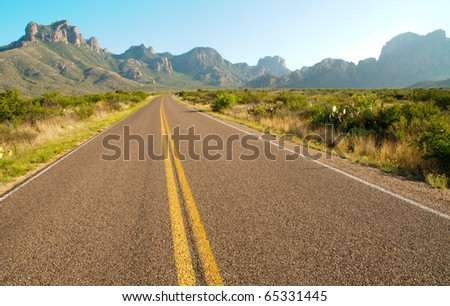 road leading into the Chisos Mountains - stock photo