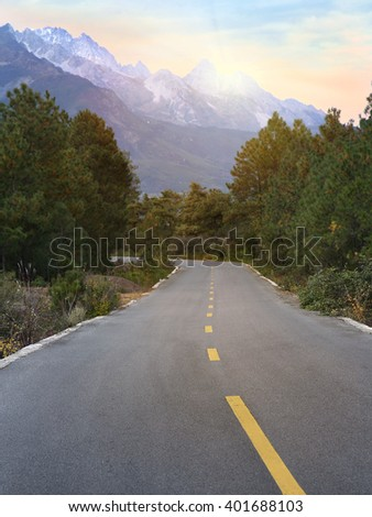 Road Leading to Mountains - stock photo