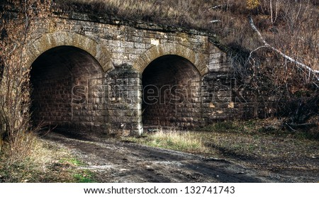 road leading to the fall of the old tunnel - stock photo