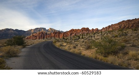 Road leading to the red rock canyon in Nevada near Las Vegas - stock photo