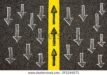 Road marking yellow paint dividing line between arrows going in different directions, Find Your Own Way concept - stock photo