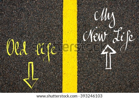 Road marking yellow paint dividing line between Old Life and New Life with arrows going in different directions, New Life concept - stock photo