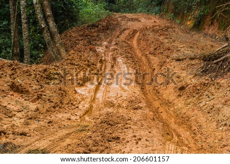 Road mud in rural north Thailand. - stock photo