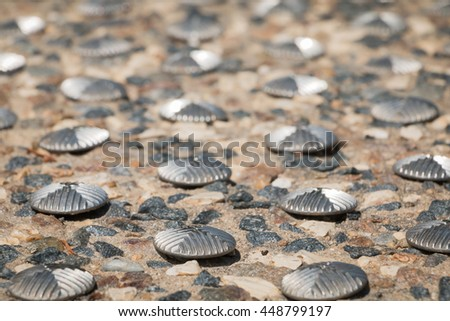 road nail on a zebra crossing - stock photo