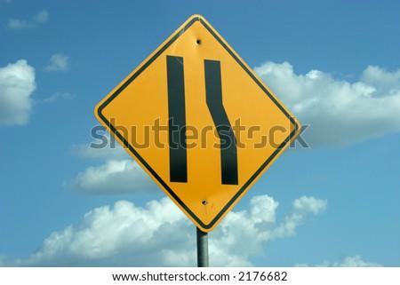 Road narrows sign - stock photo
