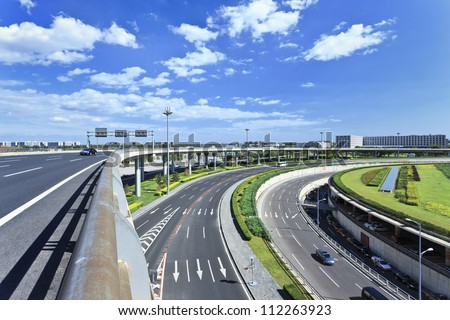 Road network around Beijing Capital Airport Terminal 3, the second largest airport terminal in the world. - stock photo