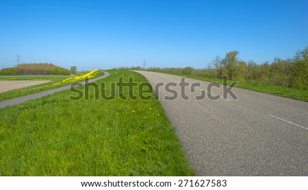 Road over a highway under a clear sky in spring - stock photo