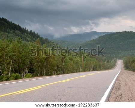 Road passing through forest, Quebec, Canada - stock photo