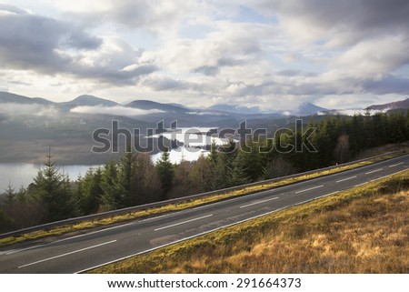 road passing through mountains with a lovely view - stock photo