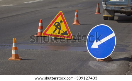 Road repairs and signs meaning a detour - stock photo
