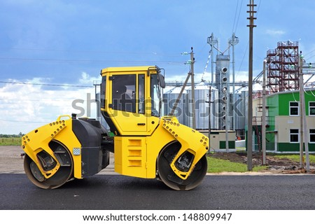 Road roller in a new highway construction - stock photo