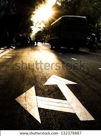 Road Sign at Sunset - stock photo