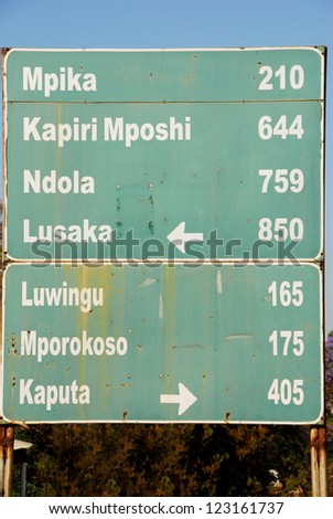 Road sign, direction to different places (Zambia) - stock photo