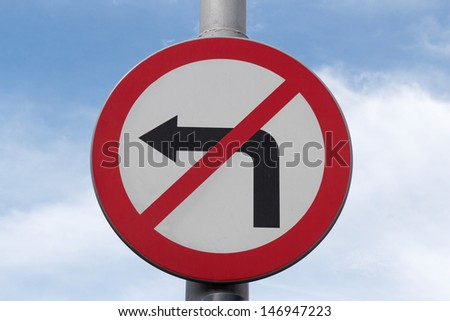 road sign don't turn left on blue sky - stock photo