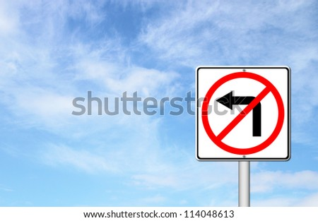 Road sign don't turn left over blue sky blank for text - stock photo