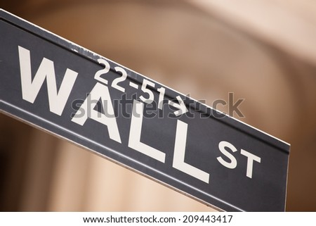 Road sign for wall street in New York City - stock photo