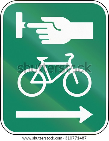 Road sign in Canada, instructing cyclists to use the crosswalk signal. This sign is used in Quebec. - stock photo