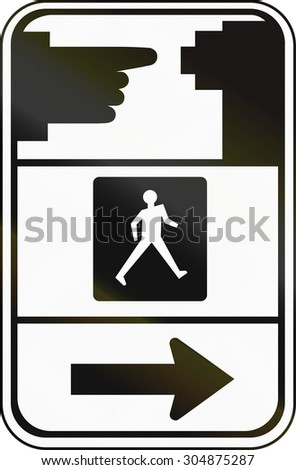 Road sign in Canada, instructing pedestrians how to use the crosswalk signal. This sign is used in Ontario. - stock photo