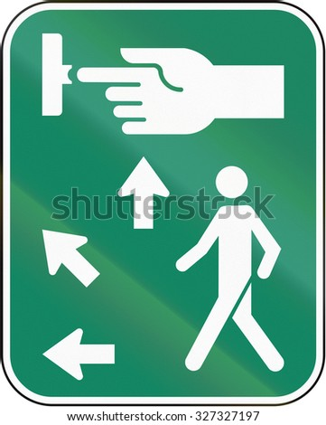 Road sign in Canada, instructing pedestrians how to use the crosswalk signal. This sign is used in Quebec. - stock photo