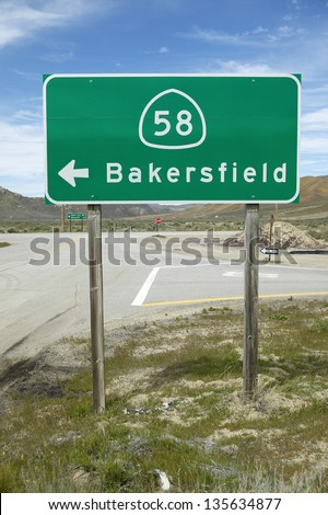 Road sign near Bakersfield California pointing to Route 58 to Bakersfield - stock photo