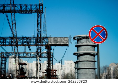 road sign â??no parking stoppingâ? on blue sky background with high-voltage line - stock photo