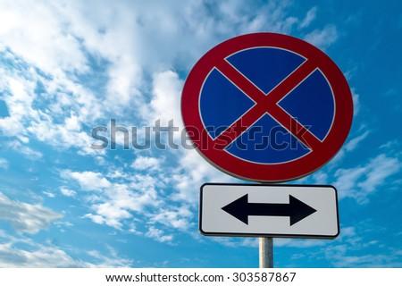 road sign No stopping against the sky - stock photo