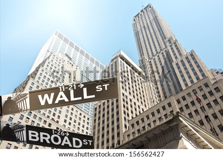 Road sign of New York  Wall street corner Broad street - stock photo