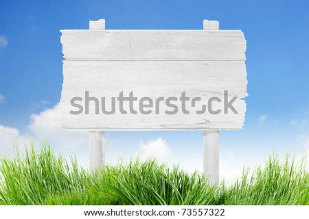 road sign on blue sky with clouds - stock photo