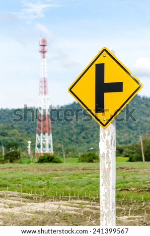 road sign on sky background,junction sign, crossroad. - stock photo