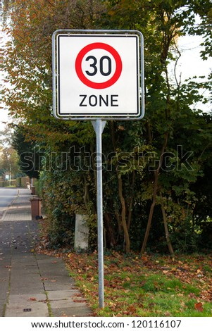 Road sign speed limit thirty zone - stock photo