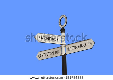road sign to Farndale - famous for wild daffodils. - stock photo