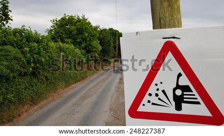 Road Sign Warning of Loose Gravel on a Country Road - stock photo